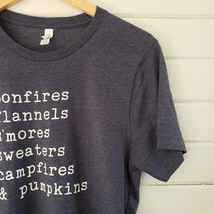 Canvas bonfires, flannels, s'mores, graphic tee